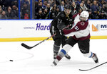 Colorado Avalanche center Nazem Kadri (91) scores a third period goal as Tampa Bay Lightning defenseman Kevin Shattenkirk (22) defends an NHL hockey game Saturday, Oct. 19, 2019, in Tampa, Fla. (AP Photo/Jason Behnken)
