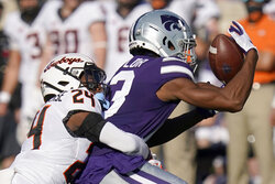 Kansas State wide receiver Chabastin Taylor (13) is tackled by Oklahoma State cornerback Jarrick Bernard-Converse (24) while catching a pass during the first half of an NCAA college football game in Manhattan, Kan., Saturday, Nov. 7, 2020. (AP Photo/Orlin Wagner)