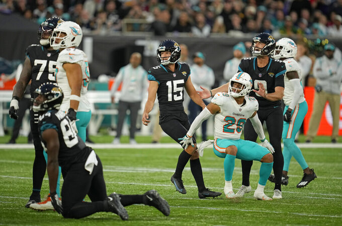 Jacksonville Jaguars kicker Matthew Wright (15), center, looks up as he kicks a field goal to win the match during the second half of an NFL football game between the Miami Dolphins and the Jacksonville Jaguars at the Tottenham Hotspur stadium in London, England, Sunday, Oct. 17, 2021. (AP Photo/Matt Dunhan)