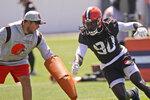 Cleveland Browns linebacker Jadeveon Clowney (90) runs a drill during an NFL football practice, Monday, Aug. 2, 2021, in Berea, Ohio. (AP Photo/Tony Dejak)