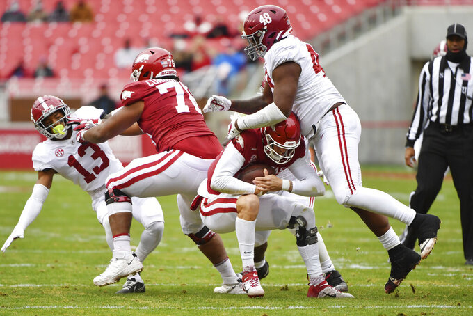 Alabama defensive lineman Phidarian Mathis (48) tackles Arkansas quarterback Feleipe Franks for a loss during the first half of an NCAA college football game Saturday, Dec. 12, 2020, in Fayetteville, Ark. (AP Photo/Michael Woods)