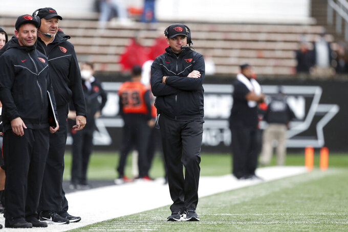 Oregon State head coach Jonathan Smith watches the field during the second half of an NCAA college football game against Idaho on Saturday, Sept. 18, 2021, in Corvallis, Ore. Oregon State won 42-0. (AP Photo/Amanda Loman)