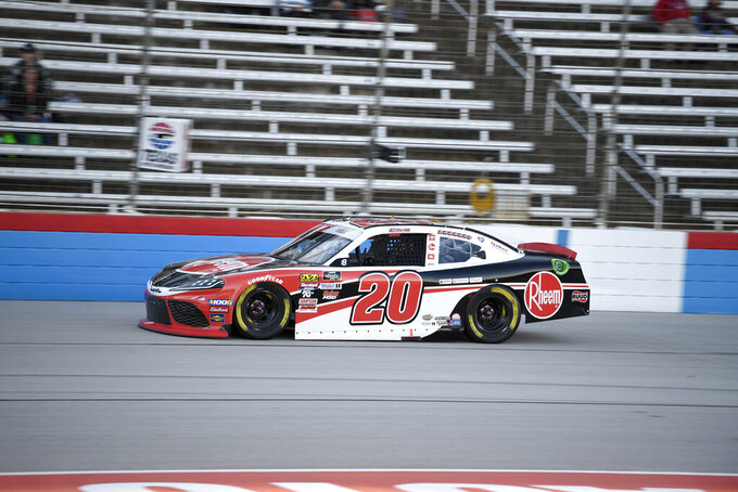 Christopher Bell heads down the front stretch during qualifying for an NASCAR Xfinity Series auto race at Texas Motor Speedway in Fort Worth, Texas, Saturday, Nov. 2, 2019. (AP Photo/Larry Papke)
