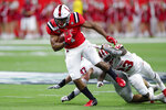 Ball State wide receiver Antwan Davis (1) is tackled by Indiana defensive back Jaylin Williams (23) during the second half of a college football game in Indianapolis, Saturday, Aug. 31, 2019. Indiana defeated Ball State 34-24. (AP Photo/Michael Conroy)