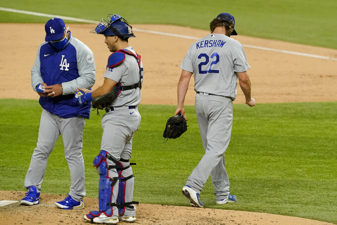 Los Angeles Dodgers starting pitcher Clayton Kershaw (22) leaves the game against the Atlanta Braves during the sixth inning in Game 4 of a baseball National League Championship Series Thursday, Oct. 15, 2020, in Arlington, Texas. (AP Photo/Tony Gutierrez)