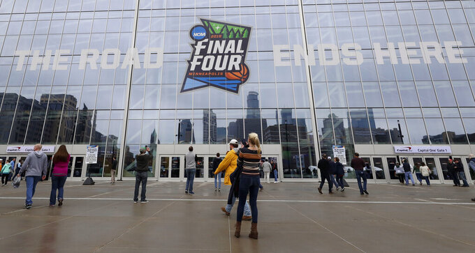 Fans arrive at U.S. Bank Stadium before a semifinal round game between Auburn and Virginia at the Final Four NCAA college basketball tournament, Saturday, April 6, 2019, in Minneapolis. (AP Photo/Matt York)