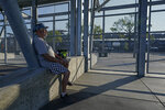 Barney Colborn sits outside of the main gate before the Indianapolis 500 auto race at Indianapolis Motor Speedway, Sunday, Aug. 23, 2020, in Indianapolis. The race is being held without fans. (AP Photo/Darron Cummings)