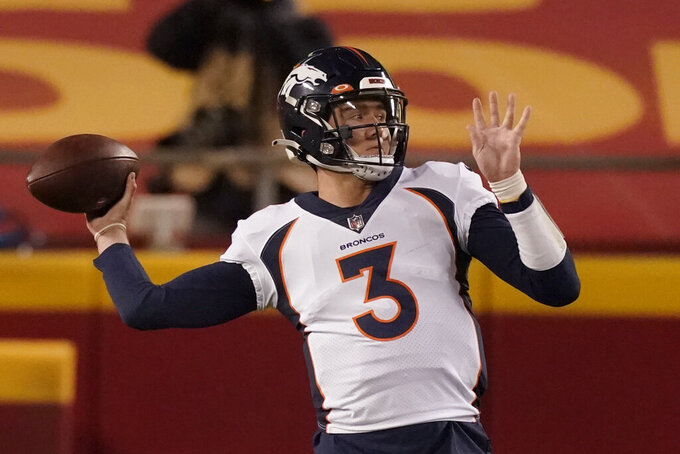 Denver Broncos quarterback Drew Lock throws against the Kansas City Chiefs in the first half of an NFL football game in Kansas City, Mo., Sunday, Dec. 6, 2020. (AP Photo/Charlie Riedel )