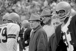 FILE - In this Nov. 7, 1971, file photo, Cincinnati Bengals coach Paul Brown, center, watches during the first quarter of an NFL football game against the Atlanta Falcons in Cincinnati, Ohio.  The Cincinnati Bengals' 14-10 victory over the Cleveland Browns on a snowy, November afternoon in 1970 put Brown's new team on equal footing with his old one and made Ohio truly a two-team pro football state. (AP Photo/Gene Smith, File)
