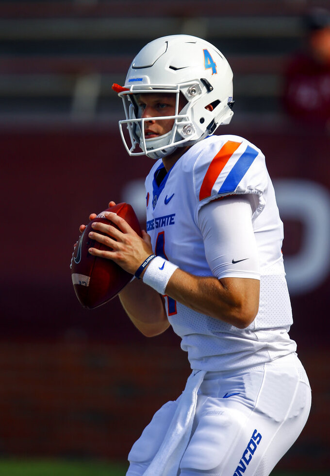 Boise State quarterback Brett Rypien (4) warms up before an NCAA college football game against Troy, Saturday, Sept. 1, 2018, in Troy, Ala. (AP Photo/Butch Dill)