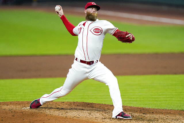 Cincinnati Reds pitcher Archie Bradley throws during the fourth inning of the team's baseball game against the St. Louis Cardinals in Cincinnati, Tuesday, Sept. 1, 2020. (AP Photo/Bryan Woolston)