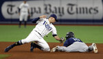 Seattle Mariners' Tim Lopes (10) steals second base as Tampa Bay Rays shortstop Willy Adames is late with the tag during the fourth inning of a baseball game Monday, Aug. 19, 2019, in St. Petersburg, Fla. (AP Photo/Chris O'Meara)