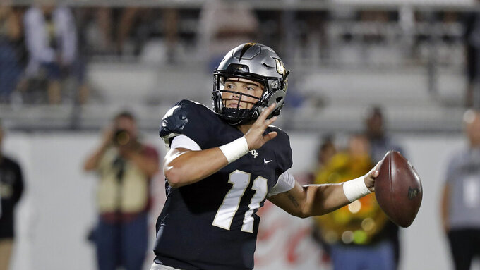Central Florida quarterback Dillon Gabriel (11) looks for a receiver during the second half of an NCAA college football game against East Carolina, Saturday, Oct. 19, 2019, in Orlando, Fla. Gabriel and the 13th-ranked Knights open American Athletic Conference play on the road Saturday at East Carolina. (AP Photo/John Raoux)