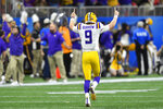 LSU quarterback Joe Burrow (9) celebrates a touchdown against Oklahoma during the first half of the Peach Bowl NCAA semifinal college football playoff game, Saturday, Dec. 28, 2019, in Atlanta. (AP Photo/John Amis)