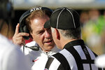 Alabama head coach Nick Saban talks with heads linesman Rod Ammari during the second half of the Citrus Bowl NCAA college football game, Wednesday, Jan. 1, 2020, in Orlando, Fla. (AP Photo/John Raoux)