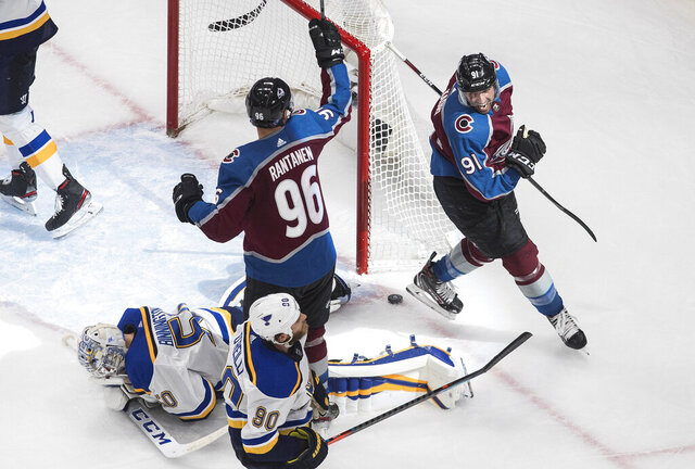 Colorado Avalanche's Mikko Rantanen (96) and Nazem Kadri (91) celebrate a goal on St. Louis Blues goalie Jordan Binnington (50) during the third period of an NHL hockey playoff game Sunday, Aug. 2, 2020, in Edmonton, Alberta. (Jason Franson/The Canadian Press via AP)