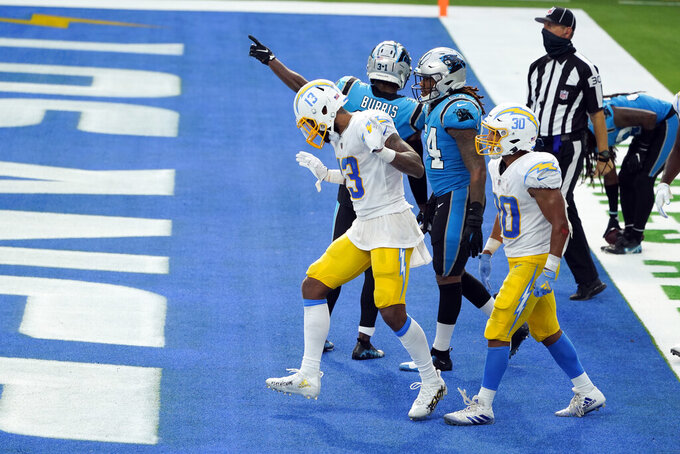 Los Angeles Chargers wide receiver Keenan Allen (13) celebrates after making a touchdown catch against the Carolina Panthers during the second half of an NFL football game Sunday, Sept. 27, 2020, in Inglewood, Calif. (AP Photo/Alex Gallardo)
