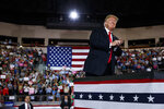 President Donald Trump arrives to speak during a campaign rally at Erie Insurance Arena, Wednesday, Oct. 10, 2018, in Erie, Pa. (AP Photo/Evan Vucci)