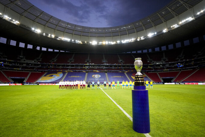 The Copa America trophy is placed on the field prior to the opening match between Brazil and Venezuela at National Stadium in Brasilia, Brazil, Sunday, June 13, 2021. (AP Photo/Ricardo Mazalan)