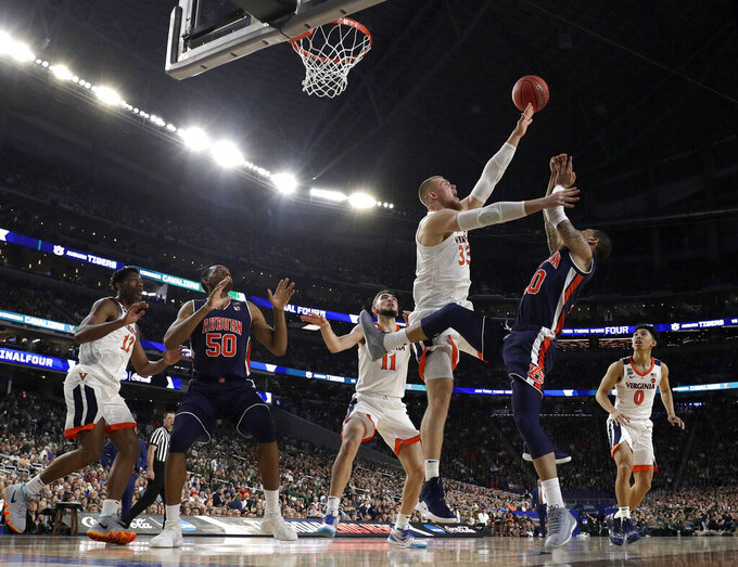 Virginia's Jack Salt (33) blocks a shot by Auburn's Samir Doughty (10) during the first half in the semifinals of the Final Four NCAA college basketball tournament, Saturday, April 6, 2019, in Minneapolis. (AP Photo/David J. Phillip)