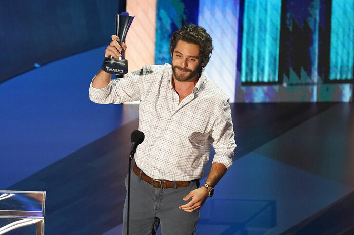 Thomas Rhett accepts the entertainer of the year award in a tie with Carrie Underwood during the 55th annual Academy of Country Music Awards at the Grand Ole Opry House on Wednesday, Sept. 16, 2020, in Nashville, Tenn. (AP Photo/Mark Humphrey)