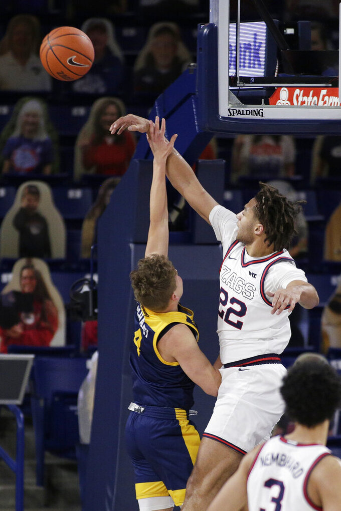 Gonzaga forward Anton Watson, right, blocks a shot by Northern Arizona guard Carter Mahaney during the first half of an NCAA college basketball game in Spokane, Wash., Monday, Dec. 28, 2020. (AP Photo/Young Kwak)