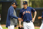 Houston Astros manager Dusty Baker, left, talks with pitcher Chris Devenski during spring training baseball practice Thursday, Feb. 13, 2020, in West Palm Beach, Fla. (AP Photo/Jeff Roberson)