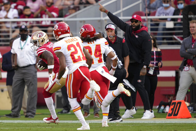 San Francisco 49ers wide receiver Trent Sherfield, left, runs in front of Kansas City Chiefs cornerback Mike Hughes (21) and safety Devon Key (24) to score on a pass from quarterback Trey Lance an NFL preseason football game in Santa Clara, Calif., Saturday, Aug. 14, 2021. (AP Photo/Tony Avelar)