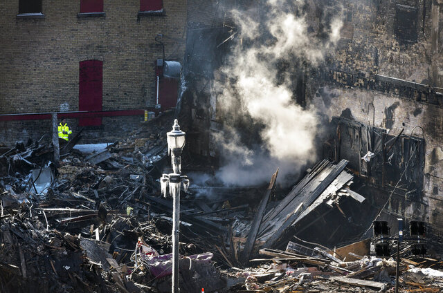 Smoke continues to rise from the rubble at the former location of the Press Bar following a fire, Tuesday, Feb. 18, 2020, in St. Cloud, Minn. The fire was reported at 2:41 a.m. Monday, and firefighters continued to fight the fire for several hours. (Dave Schwarz/St. Cloud Times via AP)
