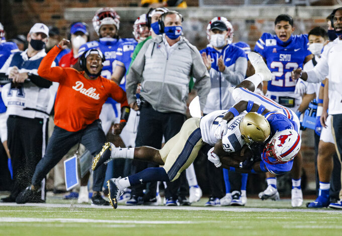 SMU safety Chace Cromartie (18) tackles Navy running back CJ Williams (20) during the first half of an NCAA college football game Saturday, Oct. 31, 2020, in Dallas. (AP Photo/Brandon Wade)