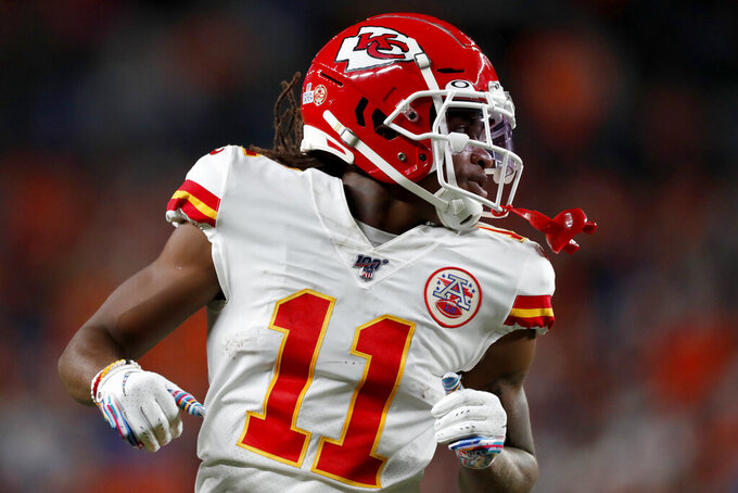 Kansas City Chiefs wide receiver Demarcus Robinson (11) runs a play against the Denver Broncos during the first half of an NFL football game, Thursday, Oct. 17, 2019, in Denver. (AP Photo/David Zalubowski)