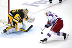 Pittsburgh Penguins goaltender Tristan Jarry (35) blocks a shot by New York Rangers' Tony DeAngelo to win a shootout and an NHL hockey game in Pittsburgh, Friday, Jan. 22, 2021. (AP Photo/Gene J. Puskar)