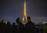 A light show illuminates the Eiffel Tower to mark Valentine's Day, in Paris, Friday, Feb. 14, 2020. Valentine's Day is observed on February 14 each year as a special day to celebrate love and romance. (AP Photo/Rafael Yaghobzadeh)