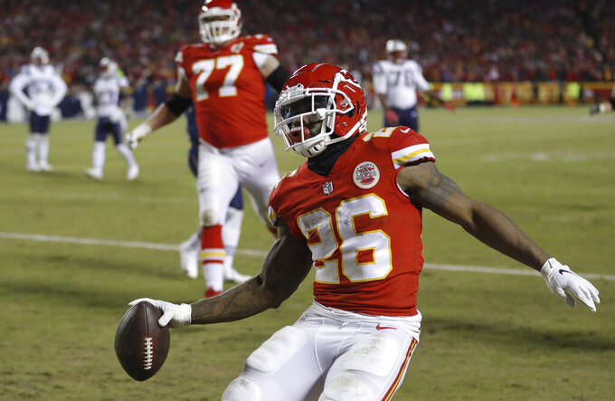 Kansas City Chiefs running back Damien Williams (26) celebrates a touchdown during the second half of the AFC Championship NFL football game against the New England Patriots, Sunday, Jan. 20, 2019, in Kansas City, Mo. (AP Photo/Charlie Neibergall)