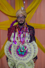 Saqib Fazili, a Kashmiri groom poses for photograph during a wedding ceremony on the outskirts of Srinagar, Indian controlled Kashmir, Wednesday, Sept. 16, 2020. The coronavirus pandemic has changed the way people celebrate weddings in Kashmir. The traditional week-long feasting , elaborate rituals and huge gatherings have given way to muted ceremonies with a limited number of close relatives attending. With restrictions in place and many weddings cancelled, the traditional wedding chefs have little or no work. The virus has drastically impacted the life and businesses in the region. (AP Photo/ Dar Yasin)