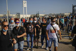 Nissan workers gather during a protest in Barcelona, Spain, Thursday, May 28, 2020. Japanese carmaker Nissan Motor Co. has decided to close its manufacturing plans in the northeastern Catalonia region, resulting in the loss of some 3,000 direct jobs. (AP Photo/Emilio Morenatti)