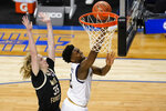 Notre Dame guard Trey Wertz (2) takes a shot as Wake Forest guard Carter Whitt (35) defends during the second half of an NCAA college basketball game in the first round of the Atlantic Coast Conference tournament in Greensboro, N.C., Tuesday, March 9, 2021. (AP Photo/Gerry Broome)