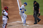 Toronto Blue Jays' Danny Jansen, center, steps on the plate after his home run as Washington Nationals catcher Kurt Suzuki watches during the fourth inning of a baseball game Monday, July 27, 2020, in Washington. (AP Photo/Nick Wass)