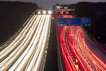 FILE -- In this Thursday, Sept. 19, 2019 long time exposure photo cars drive on a highway in Frankfurt, Germany. Germany's parliament is poised to more than double the starting price for carbon dioxide emissions from the transport and heating industries when the charge is introduced in 2021. (AP Photo/Michael Probst)