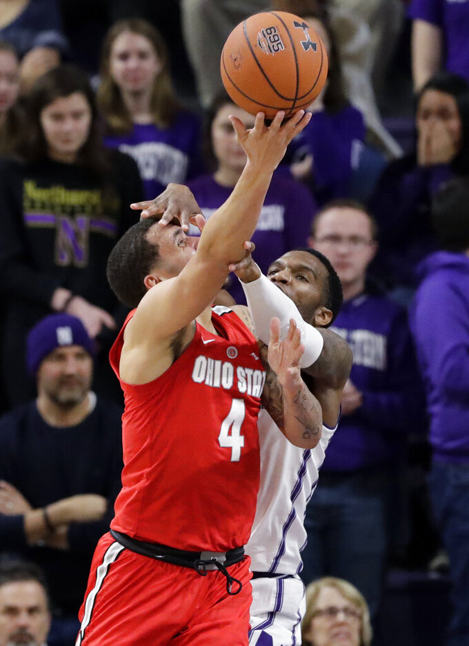 Ohio State guard Duane Washington Jr. (4) shoots as Northwestern forward Vic Law defends during the second half of an NCAA college basketball game Wednesday, March 6, 2019, in Evanston, Ill. (AP Photo/Nam Y. Huh)