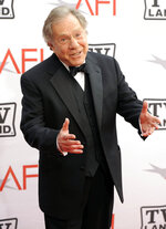 "FILE - Actor George Segal arrives at the AFI Lifetime Achievement Awards honoring Mike Nichols on June 10, 2010 in Culver City, Calif. Segal, the banjo player turned actor who was nominated for an Oscar for 1966's ""Who's Afraid of Virginia Woolf?,"" and starred in the ABC sitcom ""The Goldbergs,"" died Tuesday, his wife said. He was 87.  (AP Photo/Chris Pizzello, File)"