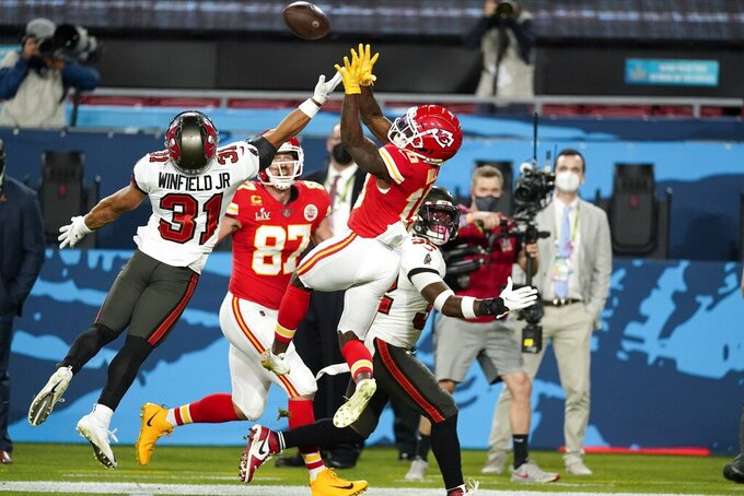 Tampa Bay Buccaneers strong safety Antoine Winfield Jr. (31) breaks up a pass intended for Kansas City Chiefs wide receiver Tyreek Hill (10) during the first half of the NFL Super Bowl 55 football game Sunday, Feb. 7, 2021, in Tampa, Fla. (AP Photo/Ashley Landis)