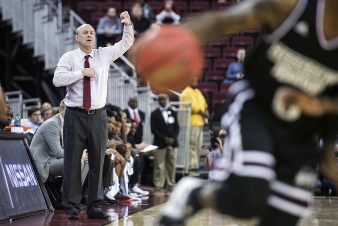 Mississippi State coach Ben Howland communicates with players during the first half of the team's NCAA college basketball game against South Carolina on Tuesday, Jan. 8, 2019, in Columbia, S.C. (AP Photo/Sean Rayford)