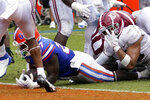 Florida running back Dameon Pierce, center, scores a touchdown past the Alabama defense including linebacker Henry To'oTo'o (10) during the second half of an NCAA college football game, Saturday, Sept. 18, 2021, in Gainesville, Fla. (AP Photo/John Raoux)
