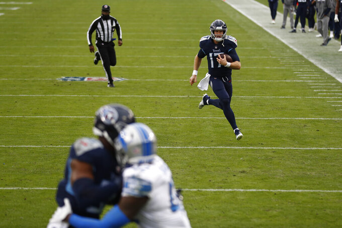 Tennessee Titans quarterback Ryan Tannehill runs for a touchdown against the Detroit Lions during the first half of an NFL football game Sunday, Dec. 20, 2020, in Nashville, Tenn. (AP Photo/Wade Payne)