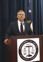FILE - In this Aug. 3, 2017, file photo, North Carolina Attorney General Josh Stein speaks to reporters in Raleigh, N.C. Negotiations aimed at reaching a major settlement in the nation's opioid litigation reached an impasse Friday, Oct. 18, 2019. Stein, who was one of the negotiators, said late Friday that local governments did not accept a deal worth $48 billion in cash, treatment drugs and services. (AP Photo/Emery Dalesio, File)