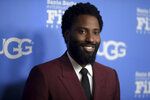 "FILE - In this Tuesday, Feb. 5, 2019, file photo, John David Washington attends the the 2019 Santa Barbara International Film Festival Virtuosos Tribute in Santa Barbara, Calif. More than $5.1 million in funds were given to over 70 nonprofit organizations during the ""HFPA Philanthropy: Empowering the Next Generation"" virtual event on Tuesday, Oct. 13, 2020. Washington was among the entertainers who appeared to discuss the charities that benefit from HFPA grants. (Photo by Richard Shotwell/Invision/AP, File)"