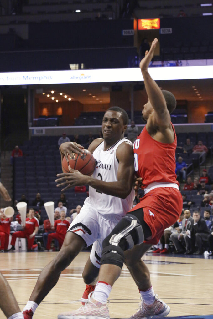 Cincinnati guard Keith Williams tries to get past SMU defender Jarrey Foster in the second half of an NCAA college basketball game at the American Athletic Conference men's tournament Friday, March 15, 2019, in Memphis, Tenn. (AP Photo/Troy Glasgow)
