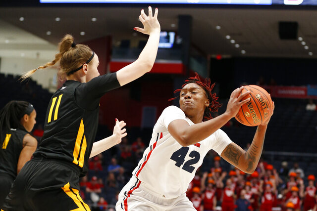 Dayton guard Jayla Scaife (42) is pressured by Virginia Commonwealth forward Kseniya Malashka (11) during the first half of the women's Atlantic 10 championship NCAA college basketball game, Sunday, March 8, 2020, in Dayton, Ohio. (AP Photo/Gary Landers)