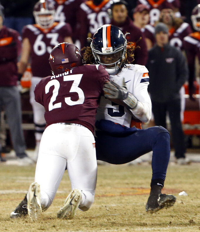 Virginia quarterback Bryce Perkins (3) is sacked by Virginia Tech linebacker Rayshard Ashby (23) and loses the football during overtime of an NCAA college football game in Blacksburg, Va., Friday, Nov. 23, 2018. Virginia Tech won 34-31. (AP Photo/Steve Helber)